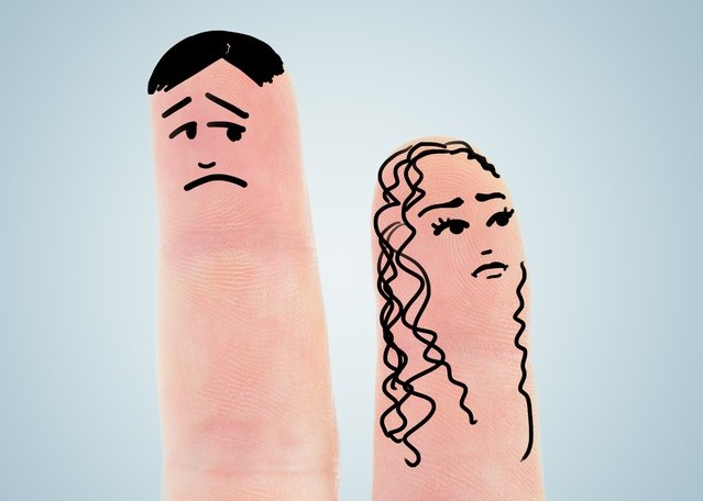 two fingers like a woman and man have fallen out, over blue back